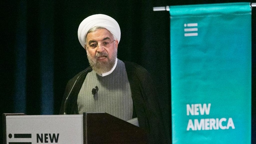 Iran President Hassan Rouhani speaks during his keynote address at New America, a public policy institute and think tank, on Wednesday, Sept. 24, 2014 in New York.  (AP Photo/Bebeto Matthews)