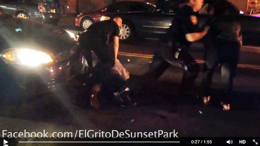 "In this Sept. 20, 2014 image taken from video and provided by Dennis Flores, a New York City police officer, left, appears to restrain a woman on the ground as another officer pushes another woman away in the Brooklyn borough of New York. The woman on the ground, identified as Sandra Amezquita, is 5 months pregnant, her attorney Sanford Rubenstein said. Police are investigating the altercation between officers and Amezquita that was captured on amateur video, officials said Wednesday, Sept. 24, 2014, Amezquita was asking police to ""stop using excessive force"" in the arrest of her 17-year-old son when the altercation happened around 2:15 a.m., Rubenstein said. (AP Photo/Dennis Flores)"