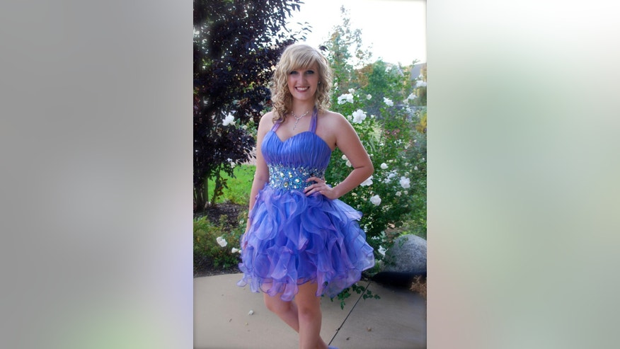 In this undated photo provided by Veronica Pehrson shows her daughter, Tayler Gillespie, 17, wearing her homecoming dance dress that failed to pass the school's dress code. Parents, and students at Bingham High School in South Jordan, Utah, say they're angry at the way school administrators enforced a dress code at a homecoming dance. The dress code said hemlines should go no higher than mid-thigh when seated. The code also says dresses should cover the chest and back at the top of the armpit and should be secured. (AP Photo/Veronica Pehrson)