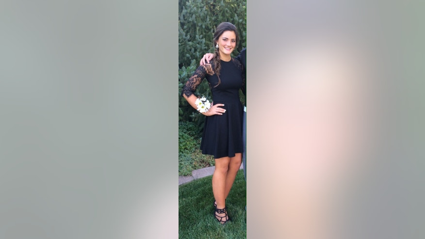 "This undated photo provided by Shannon Johnson shows her daughter Abbey Johnson, 15, wearing her homecoming dance dress that failed to pass the school's dress code. Parents and students at a Utah high school say they're angry at the way school administrators enforced a dress code at a homecoming dance. Johnson was told her dress was inappropriate and had to put on a tank top underneath in order to enter. ""They made me feel really embarrassed, along with a lot of other girls,"" Johnson said.(AP Photo/Shannon Johnson)"