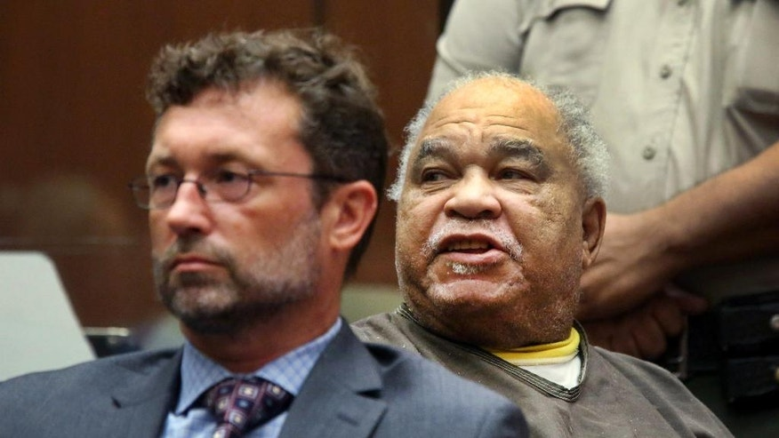 Samuel Little shouts as he is sentenced to three consecutive terms of life in prison without parole for murdering three women in the late 1980s, in a Los Angeles courtroom Thursday, Sept. 25, 2014. Little, 74, shouted out in court during his sentencing hearing that he didn't commit the killings and said he hoped for a new trial. His lawyer Michael Pentz, left, has filed a notice of appeal. (AP Photo/Nick Ut)