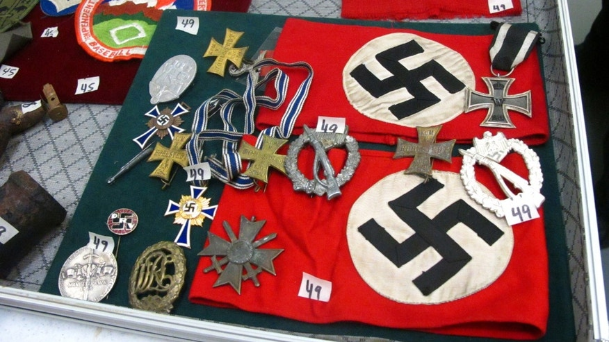 Sept. 19, 2014: This photo shows medals and Nazi armbands at an auction house in Anchorage, Alaska. Those items are among World War II items, including carbon copies of Nuremberg trial transcripts, that are being auctioned off Saturday through the Alaska Auction Co. (AP/Rachel D'Oro)