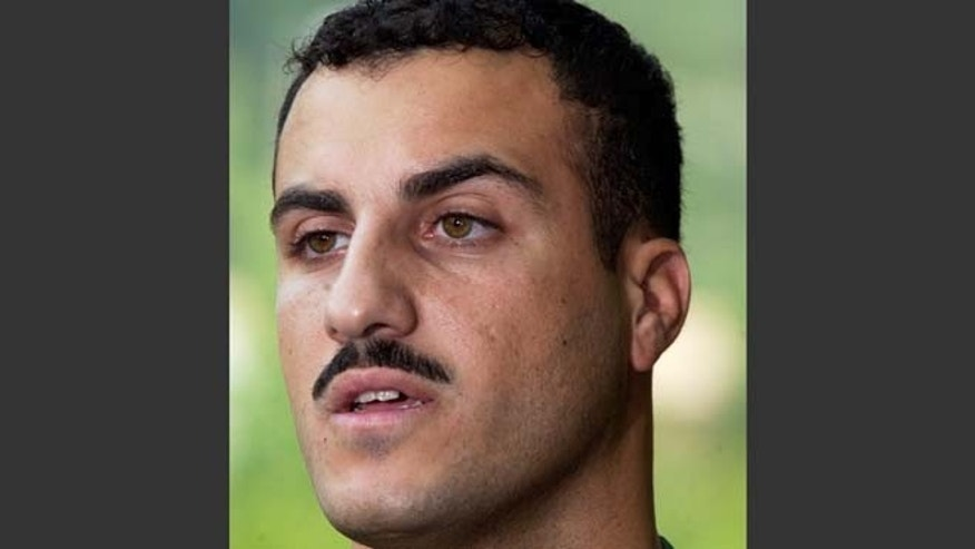 July 19, 2004: In this file photo, Marine Cpl. Wassef Ali Hassoun makes a statement to the media outside Quantico Marine Base in Quantico, Va.