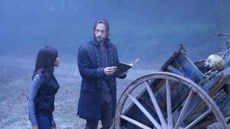 "In this undated photo released by Fox, Tom Mison, right, as Ichabod and Nicole Beharie, left, as Abbie, attempt to resurrect a Frankenstein-like monster to help rescue Katrina in the ""The Kindred"" episode of ""Sleepy Hollow,"" airing Monday, Sept. 29, 2014 (9:00-10:00 PM ET/PT) on Fox. Two of the actors from the Fox TV series, Orlando Jones and Lyndie Greenwood, are cutting a ribbon in the New York village to open the Halloween season. The village administrator says the Headless Horseman is also taking part Friday evening, Sept. 26, 2014. (AP Photo/Fox, Fred Norris)"