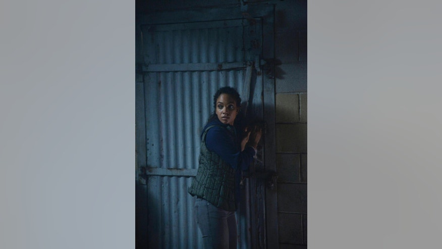 "In this undated photo released by Fox, Lyndie Greenwood as Jenny escapes certain death in the ""Hellfire"" second season premiere episode of ""Sleepy Hollow,"" which broadcast Monday, Sept. 22, 2014. (9:00-10:00 PM ET/PT) on Fox. Two of the actors from the Fox TV series, Orlando Jones and Greenwood, are cutting a ribbon in the New York village to open the Halloween season. The village administrator says the Headless Horseman is also taking part Friday evening, Sept. 26, 2014. (AP Photo/Fox, Brownie Harris)"