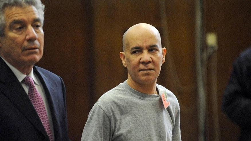 FILE - In this Nov. 15, 2012 file photo, Pedro Hernandez, right, appears in Manhattan criminal court with his attorney Harvey Fishbein, in New York. Hernandez is seen in hours of videotaped statements admitting that he choked 6-year-old Etan Patz in 1979, and then dumped his body.  A Manhattan judge must decide whether Hernandez's confession can be used at trial, but a larger question is looming: Was it all made up? (AP Photo/Louis Lanzano, Pool, File)