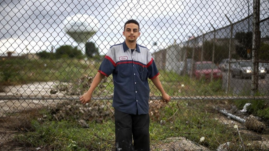 "In this Sept. 5, 2014, photo, Anderson Chaves poses for a portrait near his boyhood neighborhood in Cicero, Ill. Anderson, 17,  saw his first dead body, a gang shooting victim, when he was just six.  ""I always felt like deep inside there was something better out there for me, but I felt like it was too hard and I couldn't find a way out."" Chaves said. The vets, he said, helped showed him the way. ""They weren't there to judge us,"" said Chaves. ""Your brain is sculpted by the neighborhood you grew up in, but you can break free.""  (AP Photo/Charles Rex Arbogast)"