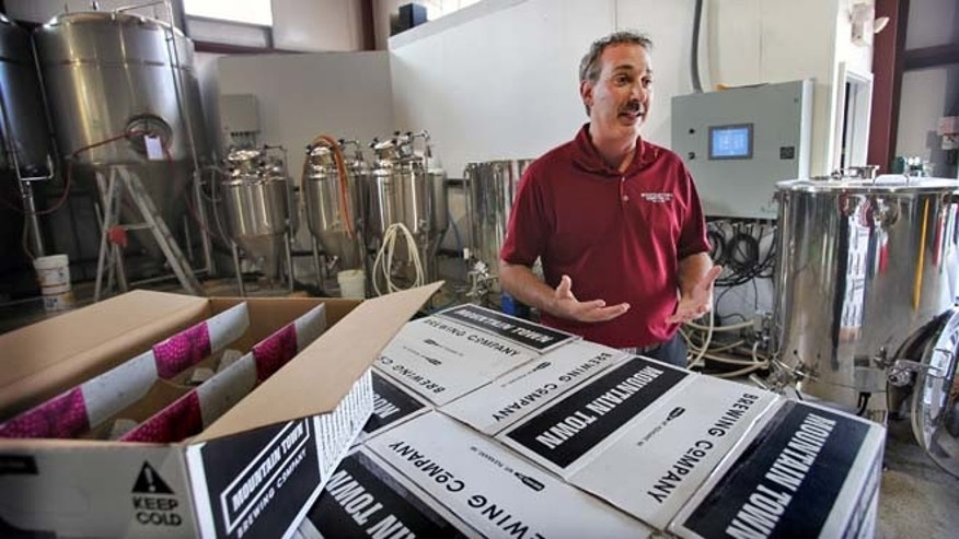 This photo released by Central Michigan University in Mount Pleasant, Mich., shows James Holton, owner of Mountain Town Station Brewing Co. & Restaurant. (AP/Steve Jessmore, Central Michigan University).