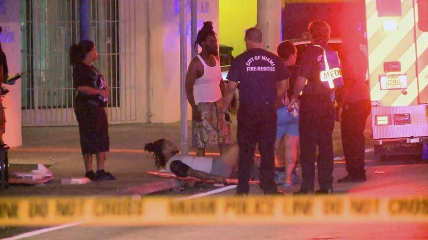In this image taken from video, emergency personnel tend to the wounded outside The Spot, a nightclub in Miami, early Sunday, Sept. 28, 2014. Fifteen people were wounded in an early morning shooting at the club, including an 11-year-old, police said.  (AP Photo/APTN)