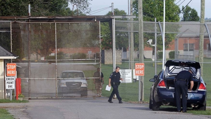 September 2, 2014: Police work in front of the Woodland Hills Youth Development Center in Nashville, Tenn. (AP Photo/Mark Humphrey)