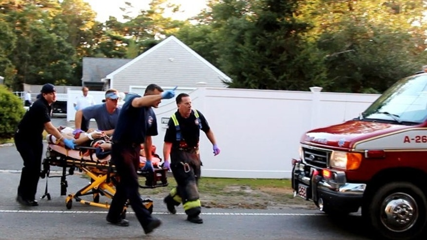 September 28, 2014: In this image taken from video provided by HyannisNews.com, a person is brought to an ambulance following a skydiving accident in Barnstable, Mass. (AP Photo/HyannisNews.com, Robert Bastille)