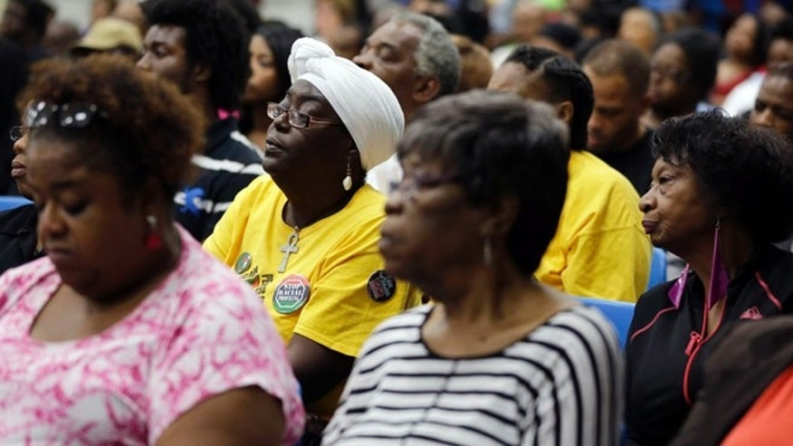 Sept. 24, 2014: Several hundred people pack a room on the St. Louis Community College Florissant Valley campus during a meeting held by the Department of Justice to talk about the agency's investigation of the Ferguson police department