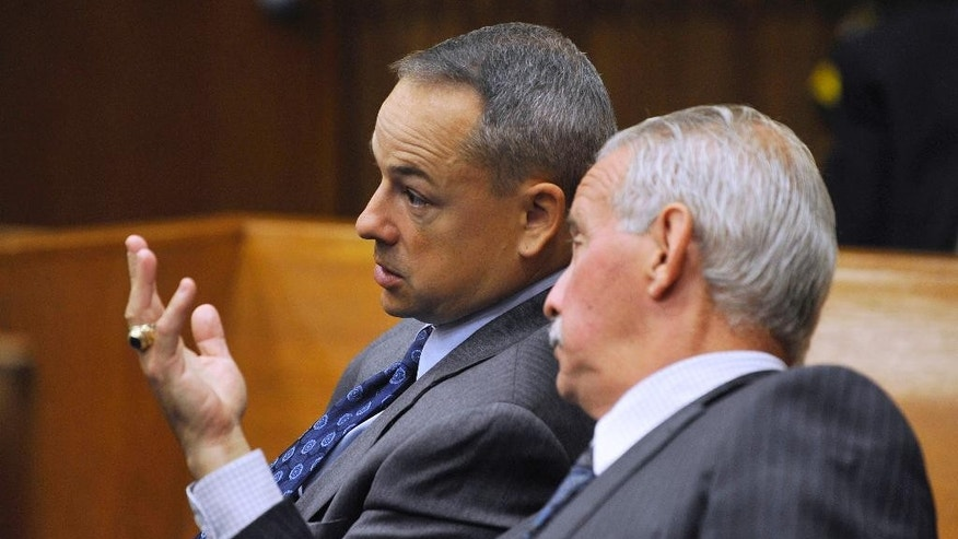 Detroit police officer Joseph Weekley, left, is seated in court as his attorney Steve Fishman speaks with him Monday, Sept. 29, 2014 in Detroit. Weekley is charged with involuntary manslaughter in the shooting death of 7-year-old Aiyana Stanley-Jones during a raid in 2010. Wayne County Judge Cynthia Gray Hathaway turned down a request for a mistrial Monday after talking to jurors. Fishman had argued that Joseph Weekley's right to a fair trial was spoiled when the victim's grandmother lashed out at the officer while testifying last week. (AP Photo/The Detroit News, Charles V. Tines)