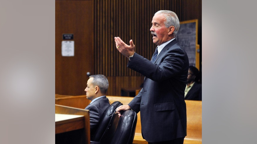 Detroit police officer Joseph Weekley, left, is seated in court as his attorney Steve Fishman requests a mistrial for his client, Monday, Sept. 29, 2014 in Detroit. Weekley is charged with involuntary manslaughter in the shooting death of 7-year-old Aiyana Stanley-Jones during a raid in 2010. Wayne County Judge Cynthia Gray Hathaway turned down a request for a mistrial Monday after talking to jurors. Fishman had argued that Joseph Weekley's right to a fair trial was spoiled when the victim's grandmother lashed out at the officer while testifying last week. (AP Photo/The Detroit News, Charles V. Tines)