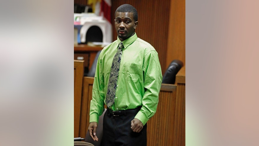 FILE -In this Friday, Sept. 26, 2014 file photo, Desmonte Leonard enters the courtroom before opening statements in Opelika, Ala. A Lee County judge told jurors to return Monday morning for a second day of testimony in the capital murder trial of 24-year-old Desmonte Leonard of Montgomery. Prosecutors say Leonard opened fire at a large party at an apartment clubhouse in June 2012. Three people were killed and three others were injured. (AP Photo/Opelika-Auburn News,  Todd J. Van Emst)
