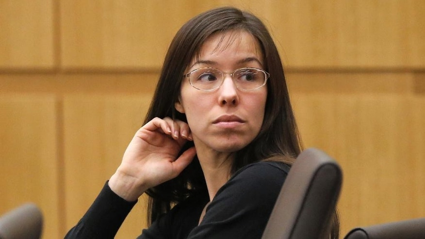FILE - In this Jan. 9, 2013, file photo, Jodi Arias appears for her trial in Maricopa County Superior court in Phoenix. Jury selection is beginning in the penalty retrial of convicted murderer Arias, as prosecutors again seek a death sentence in the Arizona case that became a tabloid TV sensation. About 300 prospective jurors will report to the courthouse in Phoenix, on Monday, Sept. 29, 2014, with more to come if an impartial panel cannot be found among the first group. A previous jury deadlocked on punishment. (AP Photo/Matt York, File)