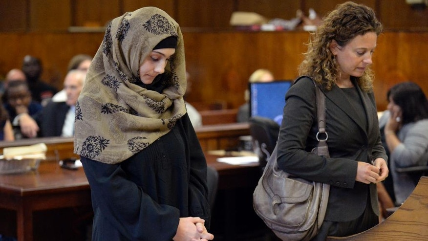 "Ailina Tsarnaeva, left, sister of Boston Marathon bombing suspect Dzhokhar Tsarnaev, and her attorney Susan Marcus, make an appearance in Manhattan Criminal Court,  Tuesday, Sept. 30, 2014 in New York.  Authorities allege Tsarnaeva of North Bergen, N.J., claimed people she knew could bomb the home of a woman who was previously involved with her husband.  Marcus, said Tuesday that the claim is ""uncorroborated.""  Bail was set at $5,000.   (AP Photo/New York Post, Steven Hirsch, Pool)"