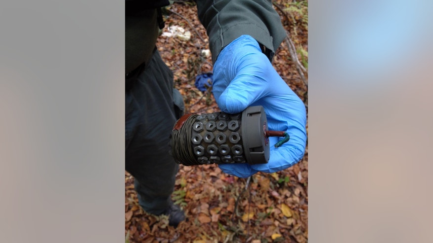 In this undated photo provided by the Pennsylvania State Police, a pipe bomb is shown.  State police searching for Eric Frein, accused of killing a trooper, said Tuesday Sept. 30, 2014, that they found two pipe bombs in the Pennsylvania woods during their manhunt that were capable of causing significant damage. The bombs were not deployed, but they were fully functional and had both trip wires and fuses, Lt. Col. George Bivens said at a news conference in Blooming Grove, Pa.  (AP Photo/Pennsylvania State Police)