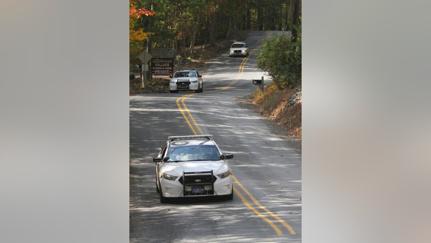 Three Pennsylvania State Police cars patrol along Snow Hill Road in Price Township, Pa, Tuesday, Sept. 30, 2014 as the search for suspected killer Eric Frein carries on for the 18th day. State police searching for Frein, accused of killing a trooper, said Tuesday they found two pipe bombs in the Pennsylvania woods during their manhunt that were capable of causing significant damage. The bombs were not deployed, but they were fully functional and had both trip wires and fuses, Lt. Col. George Bivens said at a news conference.  (AP Photo/Scranton Times-Tribune, Michael J. Mullen) MANDATORY CREDIT