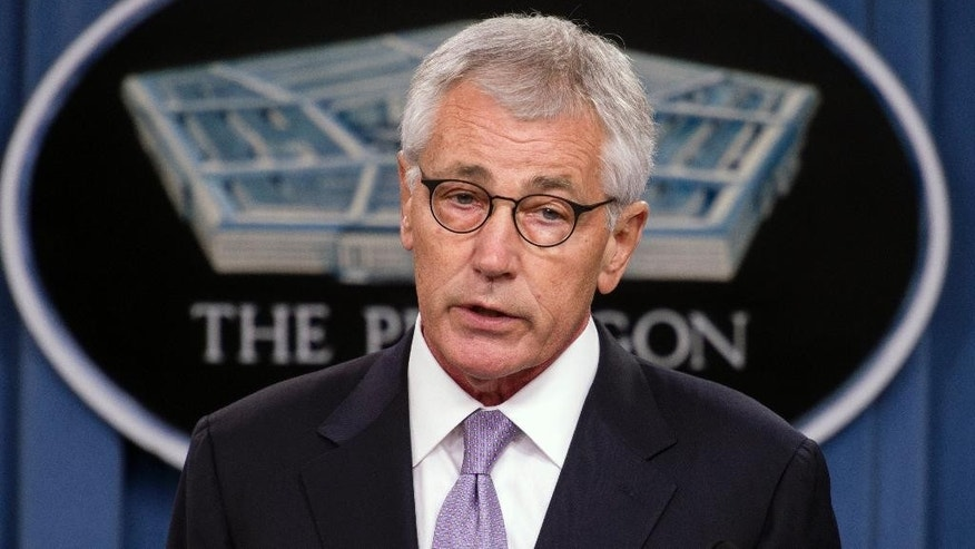 Defense Secretary Chuck Hagel briefs reporters at the Pentagon, Wednesday, Oct. 1, 2014, on the military health care system. (AP Photo/Cliff Owen)
