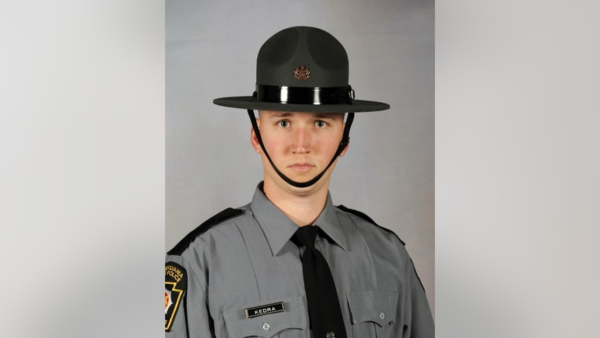 This undated photo provided by the  Pennsylvania State Police, Trooper David Kedra is shown. Kedra was shot in the chest Tuesday, Sept. 30, 2014,  during a yearly training exercise at the Montgomery County Public Safety Training Complex in Conshohocken, near Philadelphia, state police said.  Kedra, 26, was flown by helicopter to a hospital, where he was pronounced dead. He had been a member of the Pennsylvania State Police since June 2012.  (AP Photo/ Pennsylvania State Police)