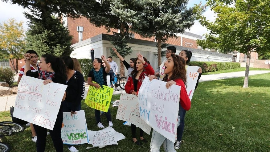 In this Sept. 29, 2014 photo, students protest against a Jefferson County School Board proposal to emphasize patriotism and downplay civil unrest in the teaching of U.S. history, in front of their school, Jefferson High, in the Denver suburb of Edgewater, Colo. (AP Photo/Brennan Linsley)