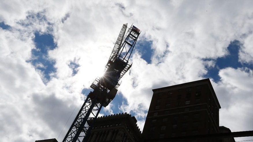 In this photo made on Monday, Sept. 22, 2014, work continues at a construction site in Pittsburgh. The Commerce Department releases construction spending for August on Wednesday, Oct. 1, 2014. (AP Photo/Keith Srakocic)
