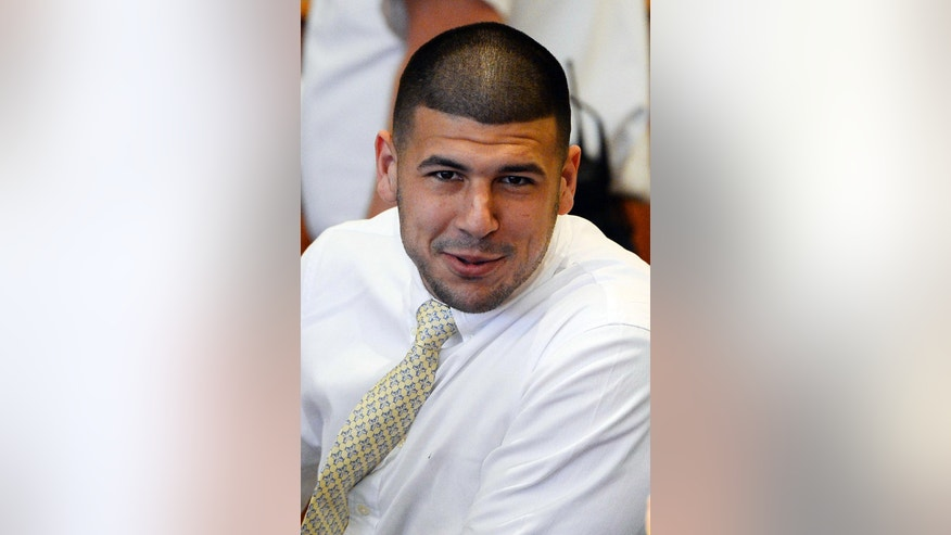 Former New England Patriots NFL football player Aaron Hernandez attends an evidentiary hearing at Bristol County Superior Court, Thursday, Oct. 2, 2014, in Fall River, Mass. Hernandez, 24, has pleaded not guilty to first-degree murder in the 2013 shooting death of Odin Lloyd, a Boston semi-professional football player who was dating the sister of Hernandez's fiancee. (AP Photo/CJ Gunther, Pool)