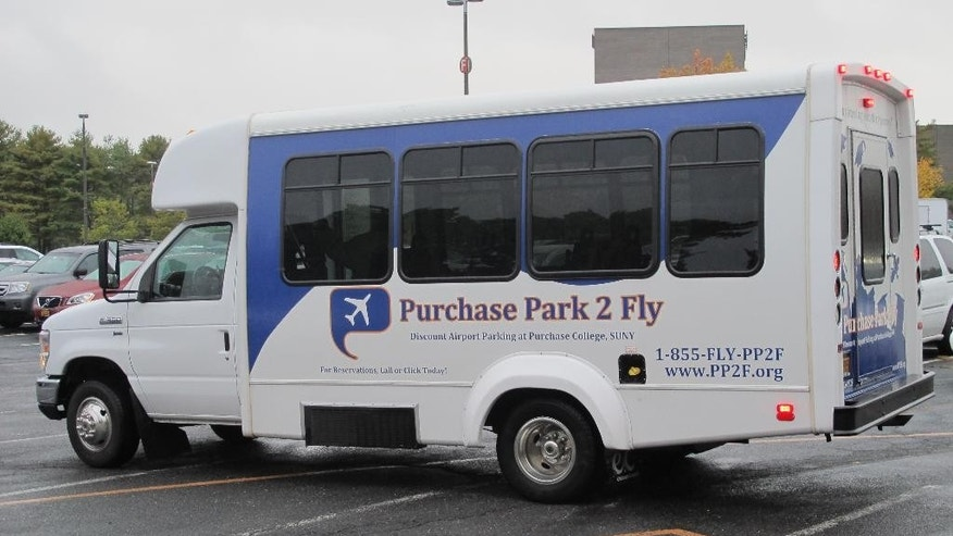 A shuttle bus leaves Purchase College in Purchase, N.Y., for the Westchester County Airport on Wednesday, Oct. 1, 2014. The college has earned hundreds of thousands of dollars by offering valet parking and a shuttle ride to the nearby airport. (AP Photo/Jim Fitzgerald)