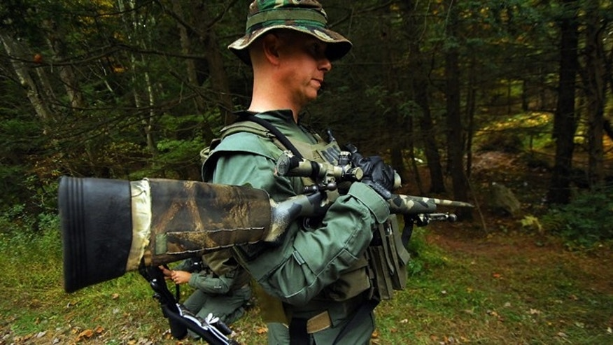 Oct. 2, 2014: A member of the Scranton, Pa., Police Special Operations Group, prepares to search the woods in Barrett Township near Canadensis, Pa., for suspected killer Eric Frein.