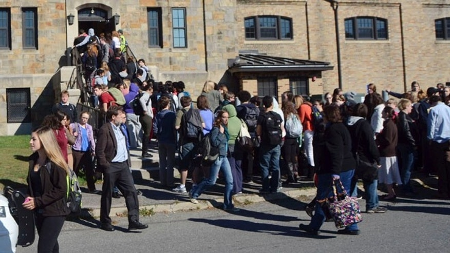Oct. 6, 2014: Massachusetts College of Liberal Arts students, faculty and staff are evacuated into the armory in North Adams, Mass., following a bomb threat on campus