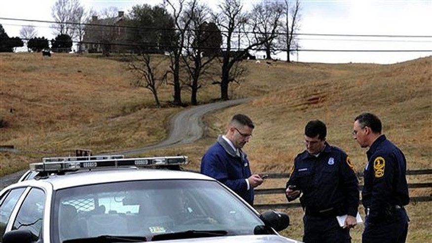 This 2010 file photo shows investigators at Anchorage Farm in Albermale County, Va., where the remains of 20-year-old Morgan Harrington were found.