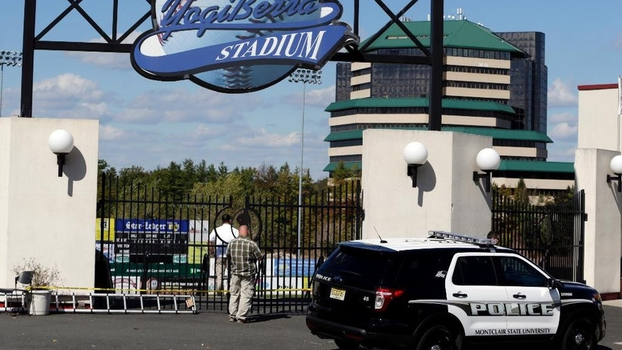 Montclair State University police officials investigate the main entrance to the Yogi Berra Stadium after a reported break-in at the Yogi Berra Museum, Wednesday, Oct. 8, 2014, in Montclair, N.J. (AP Photo/Julio Cortez)