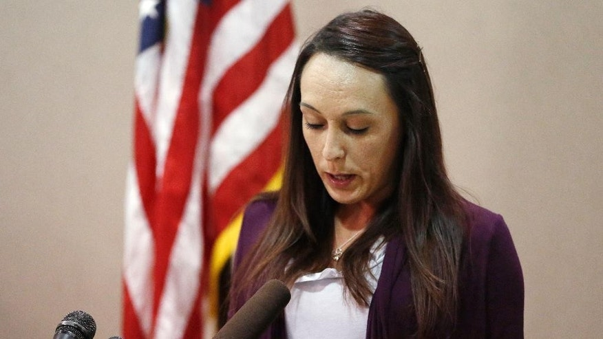 Kelli Hufford speaks about the Sept. 25 death of her mother, 54-year-old Colleen Hufford, during a news conference in Moore, Okla., Wednesday, Oct. 8, 2014. Colleen Hufford was killed in a workplace violence incident. (AP Photo/Sue Ogrocki)