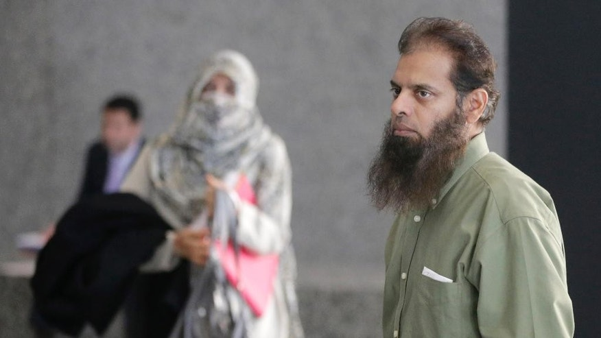 The parents of Mohammed Hamzah Khan arrive for their son's detention hearing in federal court in Chicago on Thursday, Oct. 9, 2014. The 19-year-old suburban man, accused of seeking to travel to Syria to join Islamic State militants, is charged with attempting to provide material support to foreign terrorists. (AP Photo/Charles Rex Arbogast)