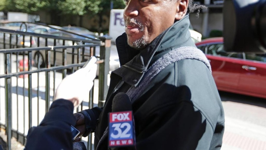 Commuter John Langston talks to reporters at a subway station where police say a gunman standing on a subway platform opened fire on a commuter train, Thursday, Oct. 9, 2014, in Chicago. Langston said he witnessed the shooting, which occurred at the LaSalle Street Blue Line station in the city's financial district. Chicago Police spokesman Martin Maloney says officers arrested a suspect a short distance away after the shooting and recovered a weapon. No injuries were reported. (AP Photo/M. Spencer Green)
