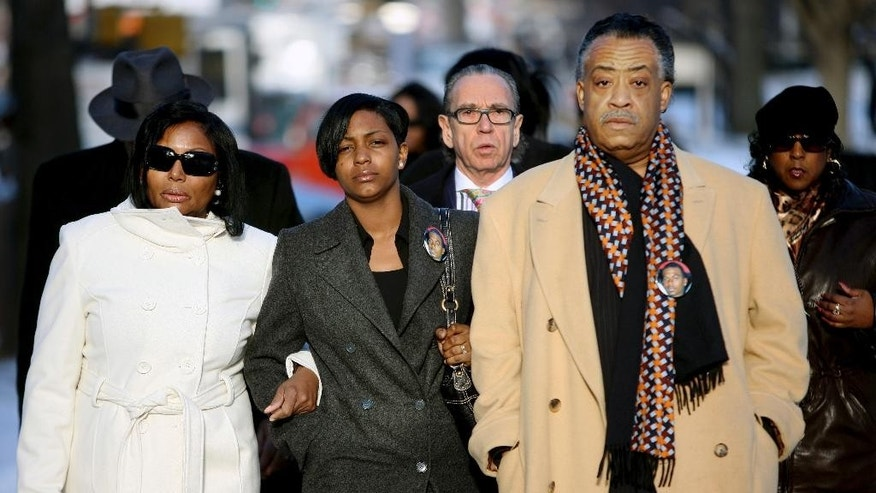 FILE - In this Feb. 25, 2008, file photo, Nicole Paultre-Bell, second from left, fiance of police shooting victim Sean Bell is accompanied by her mother Laura Harper-Paultre, far left, lawyer Sanford Rubenstein, third from left, and Rev. Al Sharpton, right, as the group arrives for opening arguments in the trial of NYPD officers charged in Bell's shooting death in the Queens borough of New York.  Rubenstein is focused on a new police investigation, as a potential rape suspect. In a turn that's whiplash-inducing even for a city where the outlandish is ordinary, the suddenly scarce Rubenstein is under scrutiny from the police force he's lambasted for years as he built a flamboyant persona and a fortune. (AP Photo/ Gary He, File)