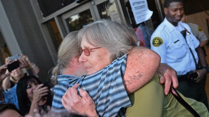 Susan Mellon gets a hug from her brother Michael Mellen outside Torrance Superior Court Friday Oct. 10, 2014 where she was exonerated and released from prison for a murder she didn't commit 17 years ago.   (AP Photo/Daily Breeze, Brad Graverson, Pool )