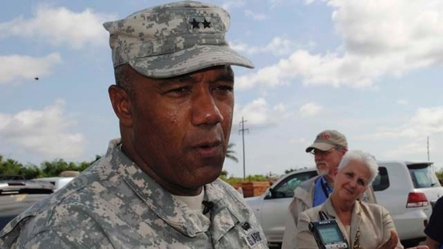 Oct. 9: U.S. Major General Darryl Williams speaks to journalists at the Roberts international airport outside Monrovia. The U.S. has sent 3,000 military engineers, medical personnel and other troops to West Africa, with its military operation lead by Williams, as part of its response to Ebola.