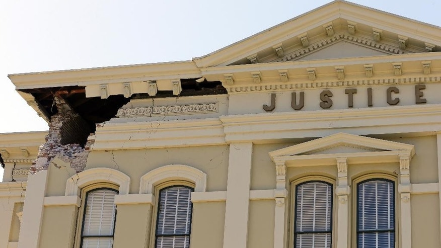 FILE - In this file photo from Aug. 24, 2014, an upper corner of the Napa County Courthouse displays structural damage after an earthquake in Napa, Calif. Four long fault segments running beneath northern California and its roughly 15 million people all have become locked far underground, and loaded with enough tension to produce earthquakes of magnitude 6.8 or greater, a geological study published Monday, Oct. 13, 2014 says. (AP Photo/Ben Margot, File)