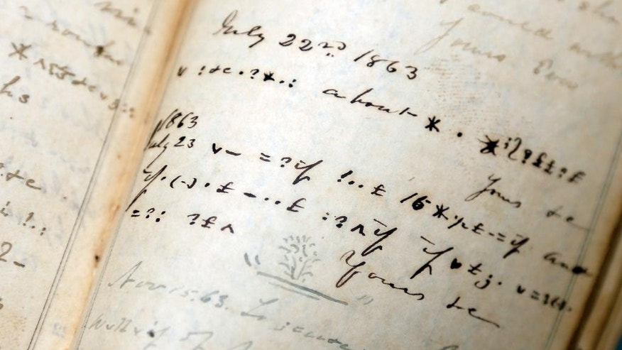 Confederate officer James M. Malbone's diary shows coded entries at the New York State Military Museum on Thursday, Oct. 9, 2014, in Saratoga Springs, N.Y. A century and a half after Malbone wrote his Civil War diary partly in code, a pair of Yankees have figured out why the Confederate officer from Virginia took the extra precaution: He liked to gossip. (AP Photo/Mike Groll)