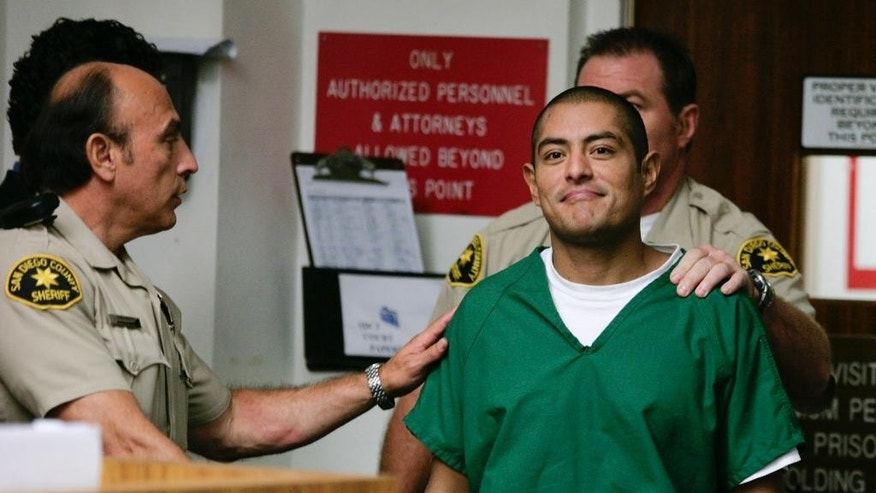 FILE - In this Aug. 13, 2009, file photo, Juan Francisco Estrada-Gonzalez is brought into the courtroom by San Diego Sheriff's deputies during his arraignment hearing on murder charges in San Diego Superior Court in San Diego. Estrada-Gonzalez and 16 other alleged members of a group of Mexican drug traffickers were indicted in the murders of nine people in the San Diego area. Estrada-Gonzalez was sentenced in San Diego County to nine life terms of life in prison without the possibility of parole Tuesday, Oct. 14, 2014, ending the longest criminal trial in county history, lasting 15 months including jury selection. (AP Photo/Denis Poroy, File)