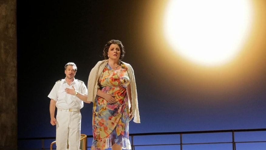 "In this image released by the Metropolitan Opera, Paulo Szot as the Captain, left, and Michaela Martens as Marilyn Klinghoffer, perform in ""The Death of Klinghoffer,""  at the Metropolitan Opera in New York. (AP Photo/Metropolitan Opera, Ken Howard)"