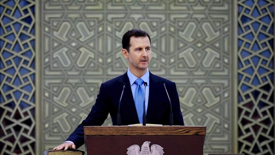 FILE - In this Wednesday, July 16, 2014 file photo released by the Syrian official news agency SANA, Syria's President Bashar Assad is sworn for his third, seven-year term, in Damascus, Syria. Despite years of diplomacy and a CIA operation to vet and train moderate Syrian rebels, the U.S. finds itself without a credible partner on the ground in Syria as it bombs the Islamic State group there, exposing a gaping hole in the Obama administration's strategy to ultimately defeat the militants. (AP Photo/SANA, File)