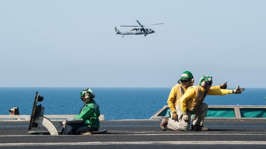 In this photo taken Friday, Oct. 10, 2014, U.S. sailors launch aircraft on the aircraft carrier USS George H.W. Bush in the Persian Gulf. On Thursday, Oct. 16, the U.S. conducted 14 airstrikes, hitting buildings controlled by the Islamic State group, sniping positions and a heavy machine gun, according to a statement issued by the U.S. military's central command. Over the last two weeks, U.S airstrikes in support of Kurdish fighters in the embattled border town of Kobani, Syria, have killed hundreds of Islamic State fighters, said Rear Adm. John Kirby. (AP Photo/Brian Stephen, U.S. Navy)