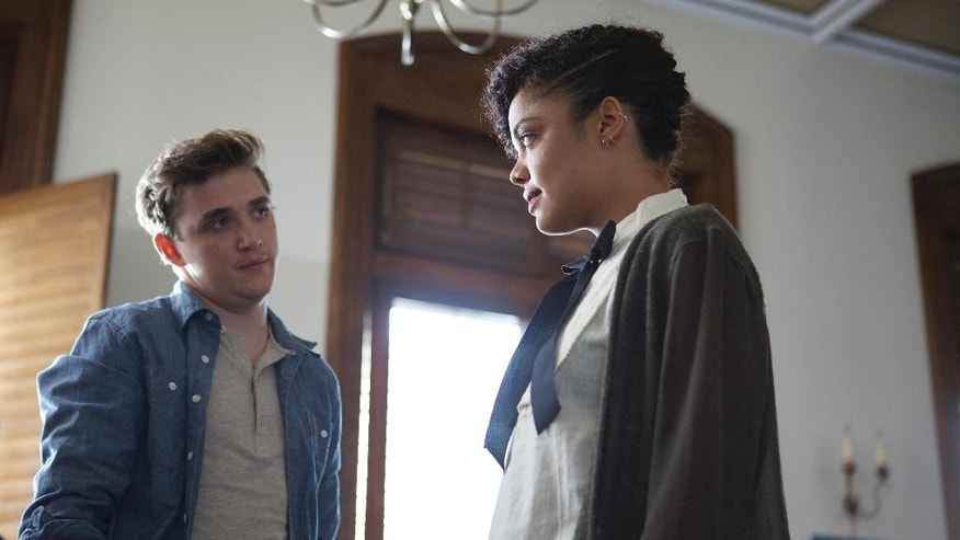 "In this image released by Roadside Attractions, Kyle Gallner, left, and Tessa Thompson appear in a scene from ""Dear White People."" (AP Photo/Roadside Attractions, Ashley Nguyen)"