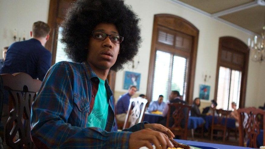 "In this image released by Roadside Attractions, Tyler James Williams appears in a scene from ""Dear White People."" (AP Photo/Roadside Attractions, Ashley Nguyen)"