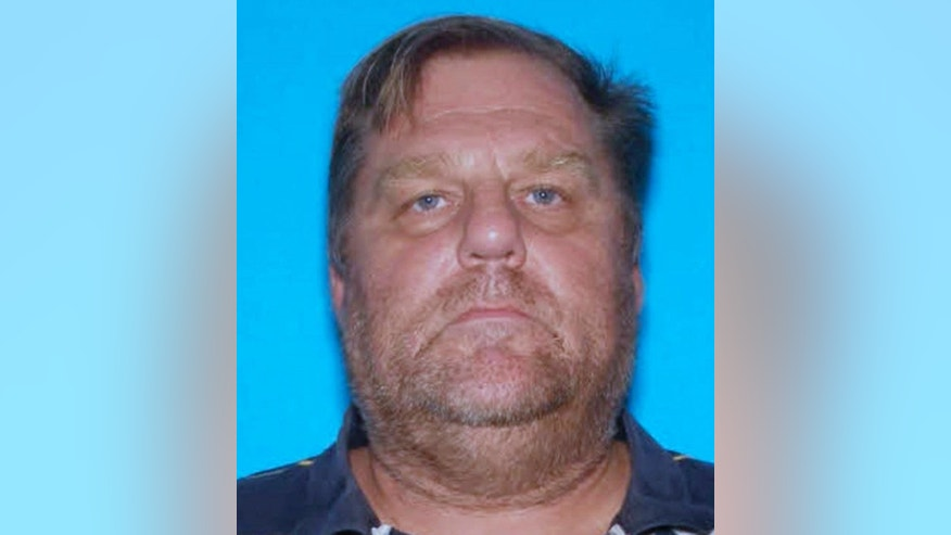 This undated photo provided by the McHenry County Sheriff's Office shows 52-year-old Scott Peters. Authorities are conducting a massive search in McHenry County for Peters, who is suspected of shooting two sheriff's deputies with a rifle early Thursday morning, Oct. 16, 2014, in Holiday Hills, Ill., when they responded to a domestic dispute. Authorities say the deputies are in stable condition. (AP Photo/Courtesy of the McHenry County Sheriff's Office)