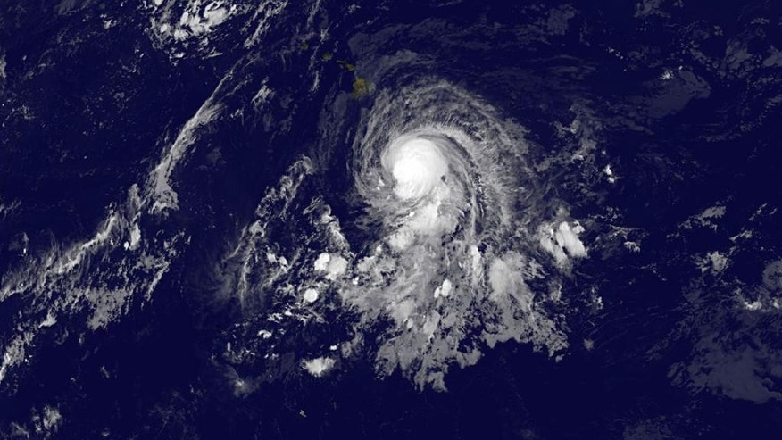 This image provided by NOAA shows tropical storm Ana taken Friday Oct. 17, 2014 at 2:00 a.m. EDT. Tropical Storm Ana likely will become a hurricane by Friday evening but return to tropical storm strength Saturday morning, National Weather Service meteorologist Ray Tanabe said. (AP Photo/NOAA)