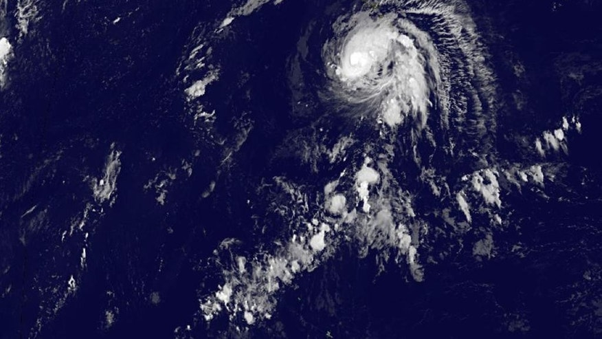 This image provided by NOAA shows tropical storm Ana taken Saturday Oct. 18, 2014 at 2:00 a.m. EDT. The National Weather Service said Friday that Ana became a Category 1 hurricane about 230 miles south of Hilo with maximum sustained winds of 80 mph. It was churning along its course at 13 mph. The hurricane was expected to gradually weaken to become a tropical storm again by early Sunday morning, Chris Brenchley, a weather service meteorologist said. The center of the powerful Pacific storm was expected to remain 150 miles away from the Big Island as it passed late Friday night. (AP Photo/NOAA)